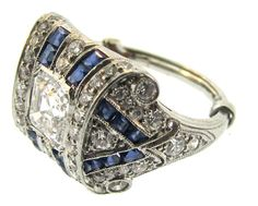Tiffany & Co Art Deco Sapphire Diamond Platinum Ring   From a unique collection of vintage engagement rings at https://www.1stdibs.com/jewelry/rings/engagement-rings/