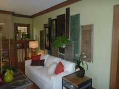 Shutters would be an interesting outside decorative element on a wall or side of the garage.