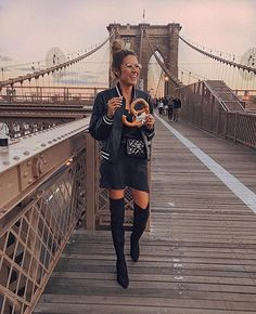 Bomber jacket and the perfect weather to break out your fave over-the-knee boots, we're loving @hellofashionblog's break from #LTKxNYFW Brooklyn Bridge walking style | Get ready-to-shop details with a screenshot with the LIKEtoKNOW.it app | http://liketk.it/2sEQr #liketkit  Via  https://www.instagram.com/p/BY1xL3sj4GW/    Cute Dresses, Tops, Shoes, Jewelry & Clothing for Women - Shop now!