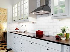 White kitchen inspiration ... in my eyes, the white subway tile backsplash is not entirely successful (tiles too big/untextured)