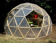 "Geodesic greenhouses...for less than 100 dollars. Using 2""x 1"" pine and pvc tubes for the intersections links, the exterior is simply covered with a thick polyethylene film. overall interior height is 6'5 and exterior diameter is about 10 feet."