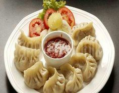 Momo - Nepalese Dumplings. It is very popular in Nepal. It can be found in the street and also in five star hotels.