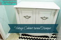 Vintage Cabinet Turned Hamper - what a great idea! This would be wonderful for hiding your bedroom hamper too!