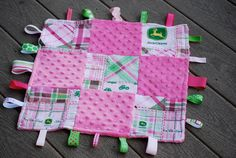 Girl pink John Deere baby blanket/lovey with ribbons- would make great shower gift. $13.00, via Etsy.