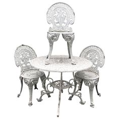 Late 20th Century Metal Garden Table With Cast Iron Chairs