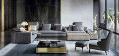 #Minotti living room ideas ! Gray upholstery mixed with dark wood center tables | Find more Minotti  living room furniture inspirations at http://www.brabbu.com/en/inspiration-and-ideas/