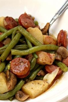 Slow Cooker Cajun Sausage, Potatoes and Green Beans--an easy one pot meal of cajun-style andouille sausage, quartered red potatoes, fresh green beans and sliced mushrooms. Drizzle the buttery broth over the potatoes for maximum flavor mealideas Cajun Sausage, Crock Pot Sausage, Sausage Crockpot Recipes, Andouille Sausage Recipes, Sausage Meals, Chicken Recipes, Recipes With Sausage, Easy Healthy Crockpot Recipes, Polish Sausage Recipes