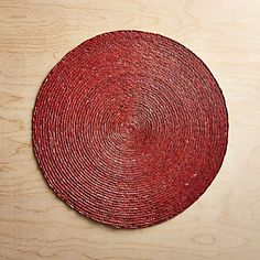 Natural Mexican palm fibers are handwoven into a round placemat, hand painted rich henna red and sealed with a wax finish. Linen Placemats, Melamine Dinnerware, Table Linens, Custom Furniture, Crate And Barrel, Crates, Paint Colors, Hand Weaving, Wax