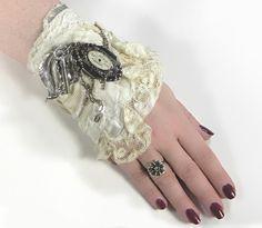 Steampunk BRIDAL - Wrist Cuff Vintage Ivory Lace Silver Florals LOCKET - As FEATURED in Cloth Paper Scissors Wedding - edmdesigns Originals. $165.00, via Etsy.