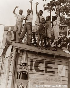 On Top of the World! | 1938    A group of African American boys clowning around on top of a refreshment/grocery stand, 1938. Photography courtesy of Black History Album, The Way We Were, uncredited.