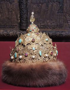 Kazan Cap Middle of the 16th century. Gold, silver, rubies, emeralds, pearls, fur. Crowned hat yellow sapphire of 90 carats. A gold filigree headdress has been made in 1553 for Ivan the Terrible, right after the conquering and annexation of the Kazakh khanate to the Russian state and strengthening of the Kazan tsar's title. According to one version, it was made by the jewelers of the conquered khanate.