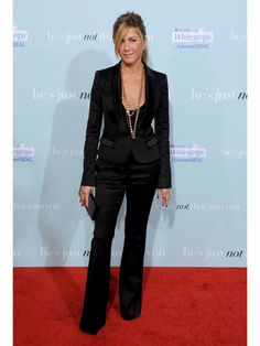 Jennifer Aniston Style Trick: Embrace Menswear Taking a break from gowns, Jennifer Aniston tried a different approach for this red carpet in 2009: a sleek Burberry tux accessorized with layered gold necklaces and a casual ponytail.
