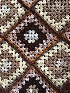 Hand crochet baby blanket. Granny squares. Tones of brown/cream. Size 41x 27.5.
