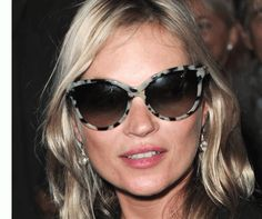 Kate Moss at Paris Fashion Week wearing cat-eye sunglasses