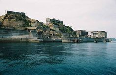 Gunkanjima, Japan. Located on an island was a profitable coal mining operation. Founded in 1916 to house mine workers, it was heavily populated by 1959 with schools, stores and a hospital. But coal was replaced by oil and in 1974 the mining company closed the mine.