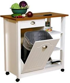 great way to hide the garbage can and utilize storage space...I am pinning this because I want that kind of garbage can thingy....not on hweels though...