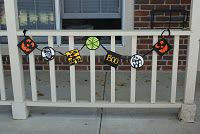 Halloween Banner, made with cardstock, cricut and ribbon