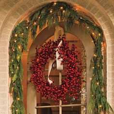 Berry Wreath | Add color to a doorway with a simple berry wreath. If you opt for a dried or faux version, you can reuse it year after year.