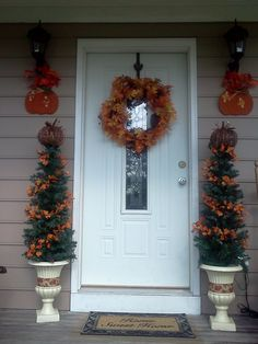 My decorated fall trees/urns