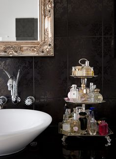 Jazz up the bathroom counter by using a cupcake stand to fabulously store commonly used items.