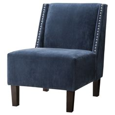 Sit in the lap of luxury with the Hayden Armless Chair. Sophisticated and smart, this upholstered chair is covered in rich blue velvet and filled with plush foam. The blue chair has a chic silhouette that works in any room—from a spacious entryway or bedroom to your living room or even a modern dining room. Plus, it's finished withnailhead trim and tapered legs, which make this slipper chair the perfect transitional piece to fit multiple décor styles.