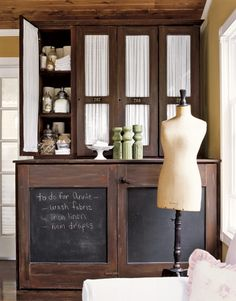 The base of this cabinet is made from two old doors that the owner painted to match the top. She also added blackboard paint on the insets.