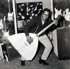 US musician Bo Diddley [r&b] seen here with bass guitar at a London music shop in September 1965