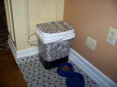 I finally did it!  I took the kitty litter container and transformed it to the Kitty FOOD Container and made it look cute so it could sit in our kitchen where the food is and not look like a container of kitty litter.      Ok, this is one of my proudest crafting moments!  LOL!!!    I used Duct Tape and Duct Tape Sheets I found on clearance at Target.
