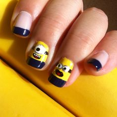 """Despicable Me Nail Art.  Minion nails were created using Ulta """"Sun-Sational"""" as the base coat.  Other nails used H&M Nail Polish """"Pink Mist.""""  Blue tips in Ulta """"Moody Blues.""""  Face details painted using a nail art brush. #nailart"""