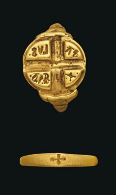 TWO BYZANTINE GOLD RINGS CIRCA 7TH-12TH CENTURY A.D. One with plain hoop, impressed cross on each shoulder, the circular bezel with central incised cross, Greek letters in each quarter; and another with plain hoop widening to bezel with incised cross