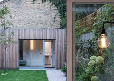 London-based Haptic Architects designed two extensions to an old Victorian house in London and created new spaces that exude warmth though the use of natural materials-untreated larch and oak-combined with subtle metal details and concrete.