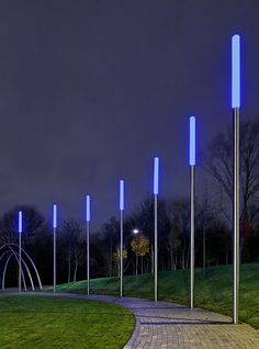 Bollards-meet-street lights to define a pedestrian via