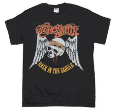 Officially licensed Aerosmith Back in the Saddle t-shirt featuring an Aerosmith skull and logo front print. Men's cotton regular fit t-shirt. This item is shipped directly from our warehouse to you and is not currently available in store. Rock T Shirts, Band Shirts, Mens Back, T Shirt World, T Shirt And Shorts, Direct To Garment Printer, Types Of Shirts, Shirt Style, Shirt Designs