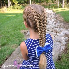 I love this combo braid that has such fun details in it. Ashton is wearing a bow from baebowss. Love!