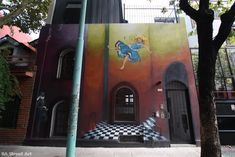 alice falling down the rabbit hole | street art | buenos aires | celine hitier