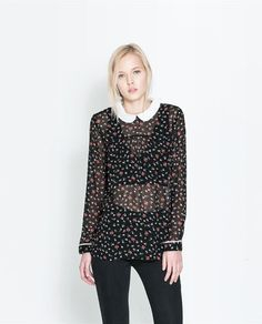 Image 1 of FLORAL TOP WITH BUTTONS ON THE BACK from Zara