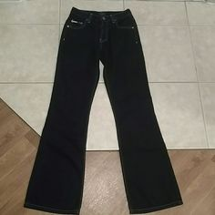 Tommy Hilfiger jeans. Free shirt FREE TOMMY SHIRT MEDIUM.Tommy Hilfiger jeans. These are a rich dark blue, so dark almost black. Beautiful pair of jeans. These were washed once. These are a hipster flare leg. 65%cotton 35%polyester Tommy Hilfiger Jeans Flare & Wide Leg