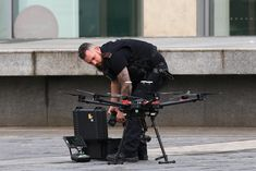 A Police officer uses a drone as he works outside the Arndale Centre shopping complex in Manchester, northwest England on October 11, 2019, following a series of stabbings. - Police arrested a man on terror charges Friday after a mass stabbing at a shopping centre in Manchester, northwest England, that left five people injured. The man in his 40s was 'lunging and attacking people' with a large knife in the Arndale shopping centre, Police Chief Russ Jackson said. The suspect was detained