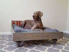 Most pets love to have a bed of their own and to sleep in their own space. Now you can get your couch back and give them the dream space they want. With PeaceLoveWood's My Best Friend's Custom Solid Wood Pet Bed, you not only have the option of choosing the stain color with your space but you can also customize the bed by adding your pet's name to the headboard and choose the picture design to make sure everyone knows that bed is just for your best friend. With 100% solid wood, handmade i...