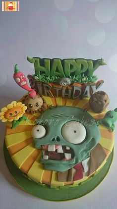 Plants Vs Zombies Themed Cake Inspired by the game, made this cake for a 9 year old boy. All the decorations were handmade and edible.