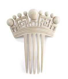 Ivory hair comb with greek key motif.  1880s-1920.