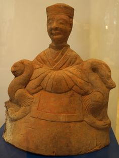 Earthenware figurine depicting the Queen Mother of the West. Circa 2nd century, Eastern Han dynasty. Cat # 2000.106.1740. From the Joey and Toby Tanenbaum Gallery of China at the Royal Ontario Museum