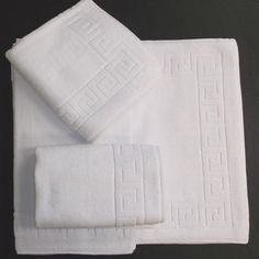 @Overstock - The most preferable size of 5 star hotels, this 1,000 GSM mat set feels soft, thick and luxurious. The Greek key pattern is weaved with twisted Turkish yarn.  http://www.overstock.com/Bedding-Bath/Salbakos-Greek-Key-Pattern-Bath-Mat-3-pc-Set/7329671/product.html?CID=214117 $28.99