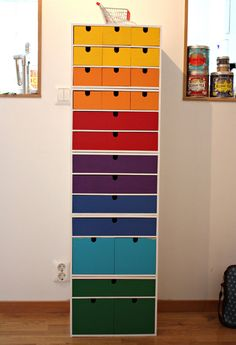 Stacked and brightly painted Ikea mini dressers. This would be awesome in a kid's room.
