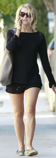 Who made  Julianne Hough's black studded sweater and green flat shoes?