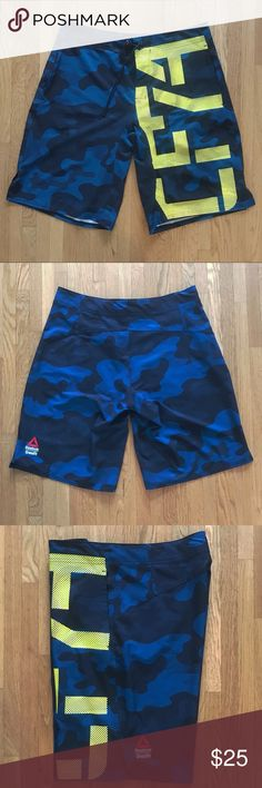 Reebok CrossFit Camo Board Shorts Men's Size Med Crossfit 4 way stretch board shorts! Go from your workouts to the water and back again! Then spend the day in them as casual shorts. Very versatile with two side pockets and they move with you no matter what activity your doing. Quick dry and moisture wick fabric allow easy transition from wet to dry activities. Has a drawstring, CrossFit logo, and reflective graphics on left leg. Worn a few times, great condition. 87% Polyester 13% Spandex…
