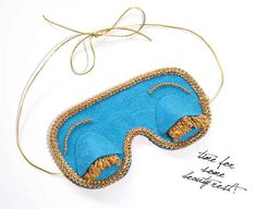 Pair this hand-decorated eye mask with her favorite lotion or moisturizer for a treat-yo'-self reminder.