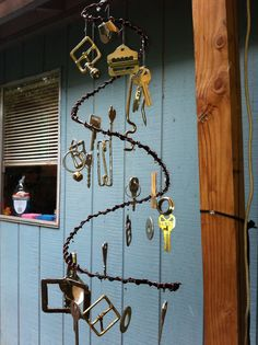 windchime i made from scrap metal pieces (mostly keys and belt-buckles) and jewelry wire, hanging from fishing line.