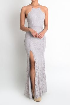 Pre-Order.. Ship date is July 29th. Please only purchase if you are okay with the wait time. Floor length lace dress.. Featuring high slit and halter neck..The