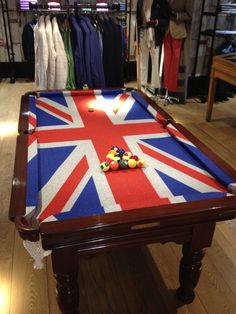 Antique Snooker / Pool Table at Hackett London with Union Jack cloth. Restored by Browns Antiques Billiards and Interiors.